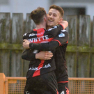 Job done: Goalscorer Jordan Forsythe is congratulated by Gavin Whyte