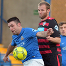 Contest: Gareth McConaghie sticks tight to Glenavon's Eoin Bradley