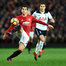 Touch: Henrikh Mkhitarayan takes control as Spurs' Harry Winks closes in