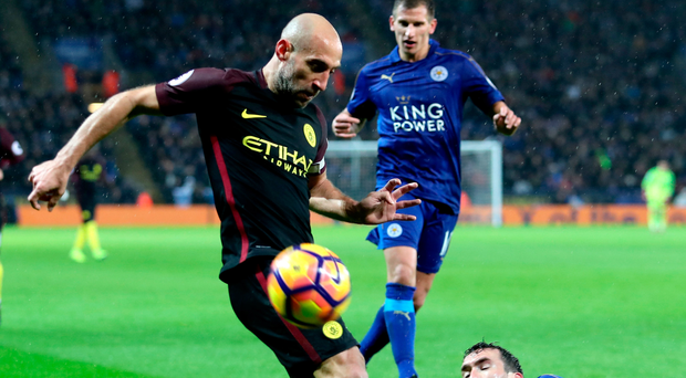 Outfoxed: Pablo Zabaleta is tackled by Christian Fuchs