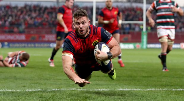 Ruthless: Munster's Jaco Taute scores his side's third try