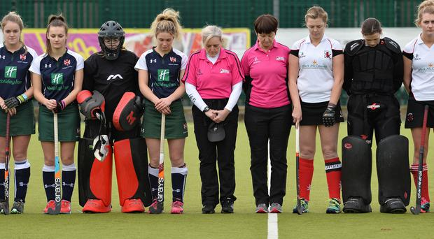 Respect: players from Queen's and Raphoe hold a minute's silence for Austin Hunter