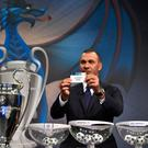 Netherlands' former striker Ruud Gullit shows the name of Arsenal during the draw for the round of 16 of the UEFA Champions League football tournament at the UEFA headquarters in Nyon on December 12, 2016. / AFP PHOTO / Fabrice COFFRINIFABRICE COFFRINI/AFP/Getty Images