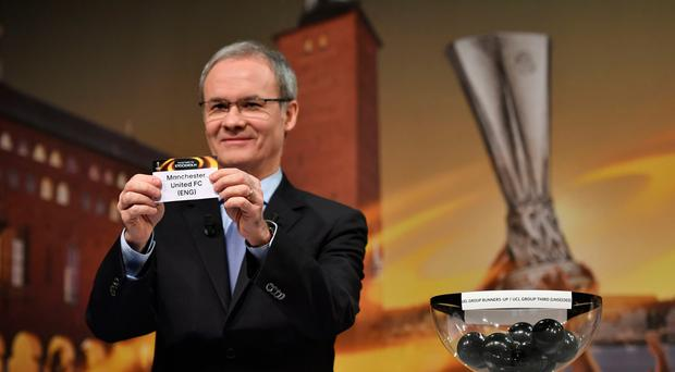 UEFA deputy secretary general Giorgio Marchetti holds the name of Manchester United during the draw for the round of 32 of the UEFA Europa League football tournament at the UEFA headquarters in Nyon on December 12, 2016. / AFP PHOTO / Fabrice COFFRINIFABRICE COFFRINI/AFP/Getty Images
