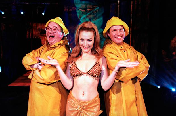 File photo dated 22/11/1996 of singer Gina G as she takes part in the 'Children In Need' party with dancing weathermen Ian McCaskill (left) and Richard Edgar. Former weather forecaster McCaskill has died aged 78, the BBC confirmed. PA