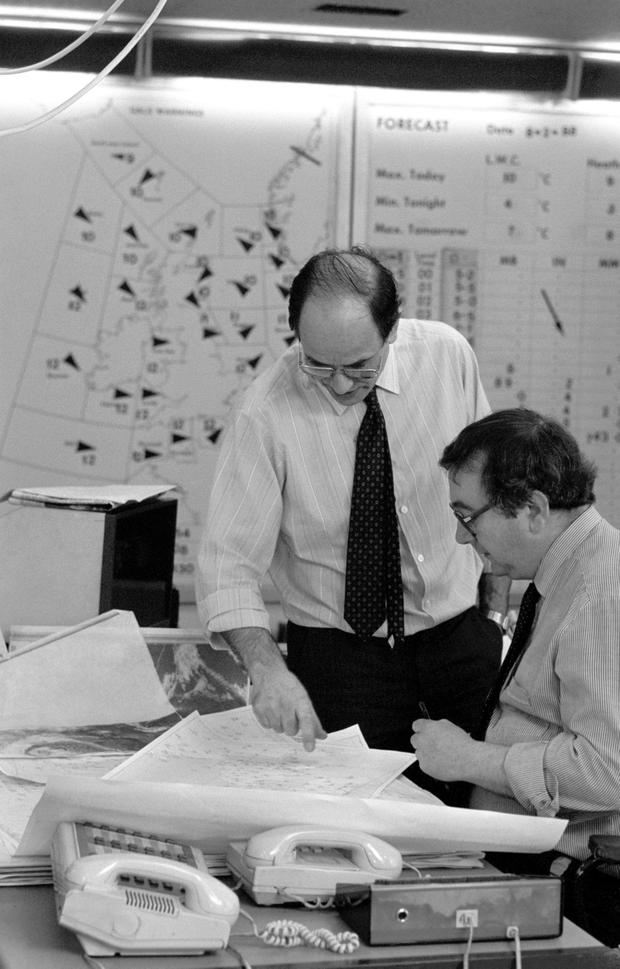 File photo dated 9/2/1988 of Ian McCaskill and a colleague, prepare for the weather forecast in London. The former weather forecaster has died aged 78, the BBC confirmed. PA
