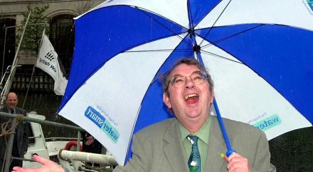 Ian McCaskill shelters from the rain at the launch of the Water Month 2000 in the West India Docks, London. (File photo dated 3/5/2000) PA