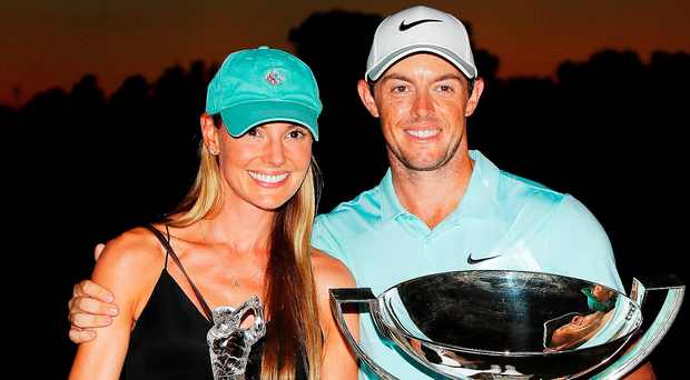 What a feeling: Rory McIlroy and fiancee Erica Stoll with the FedEx Cup and Tour Championship trophies