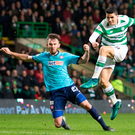 Shooting stars: Celtic's Tom Rogic fires a shot against the post