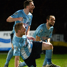 Hen party: Ballymena's Darren Henderson, on ground, celebrates his strike for United's conclusive third goal to take them into League Cup final