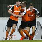 All smiles: Tiarnon McNicholl is hailed after netting what turned out to be the winner