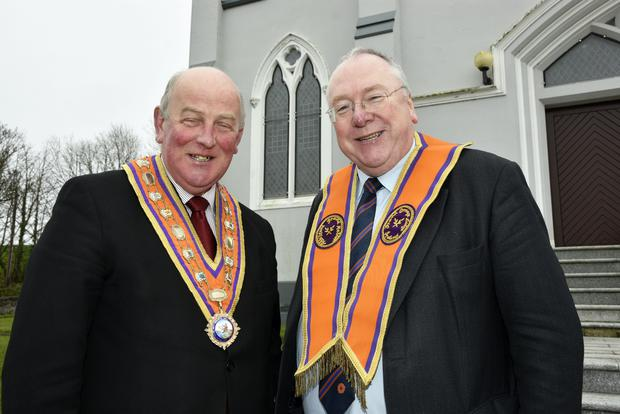 Grand Master of the Grand Orange Lodge of Ireland, Edward Stevenson (left), congratulates Rev Mervyn Gibson on his election as Grand Secretary of the Loyal Institution