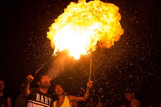 A partygoer breathes out fire during the Full Moon Party on Ko Phangan island in the southern Thai province of Surat Thani on the night of December 14, 2016. AFP/Getty Images