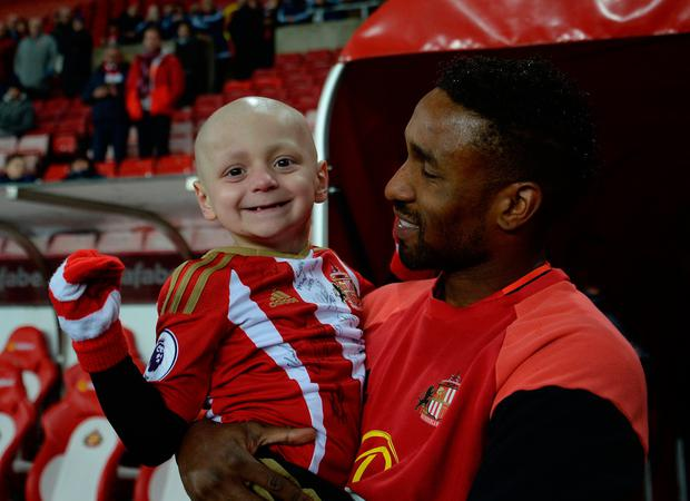 Bradley Lowery, aged five, who is terminally ill with cancer, meets Sunderland's Jermain Defoe before the Premier League match at the Stadium of Light, Sunderland. PA