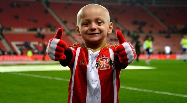 Bradley Lowery, aged five, who is terminally ill with cancer, stands on the pitch before the Premier League match at the Stadium of Light, Sunderland. PA