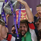 Big lift: Michael Graham raises the Senior Cup last December