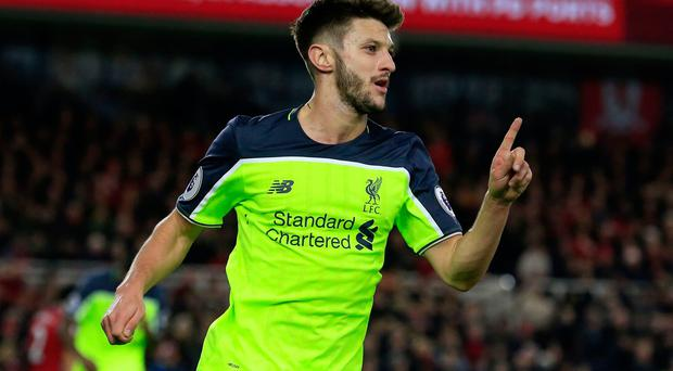 Liverpool midfielder Adam Lallana celebrates scoring his team's third goal during the English Premier League football match between Middlesbrough and Liverpool at Riverside Stadium in Middlesbrough, northeast England on December 14, 2016. AFP/Getty Images