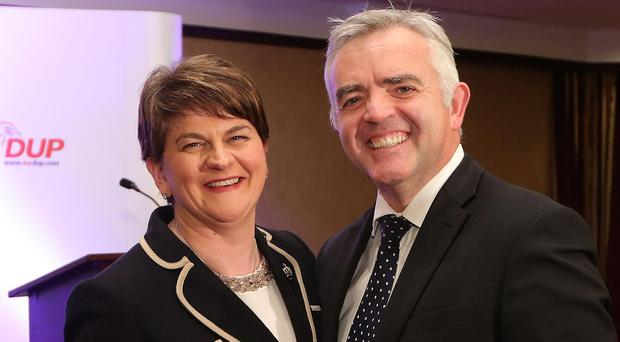 Jonathan Bell congratulates Arlene Foster on her appointment as DUP leader last year