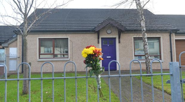 Flowers left at the scene after A man in his 50s died in a fire at a house in the East Link area of Holywood, County Down on Saturday. Pic Colm Lenaghan/Pacemaker