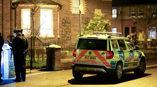 Police officers at the scene of a paramilitary style shooting in the Cluain Mor Drive area of West Belfast where A 32 y/o man has been shot in the property on 17th December 2016 ( Photo by Kevin Scott / Belfast Telegraph )