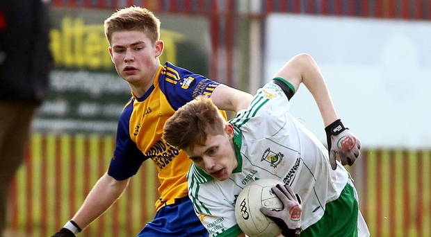 Man on: Burren's Ardan McAvoy comes under pressure from Enniskillen Gaels ace Paddy Cassidy