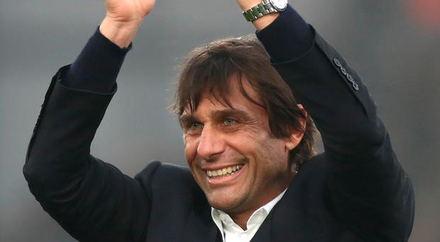 All smiles now: Antonio Conte