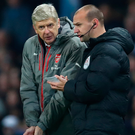 Dispute: Arsene Wenger with fourth offical Robert Madley