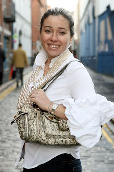 Handbag lover: Cathy Martin with her python-skin Gucci bag