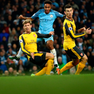 City slicker: Raheem Sterling fires Manchester City's winner against Arsenal at the Etihad