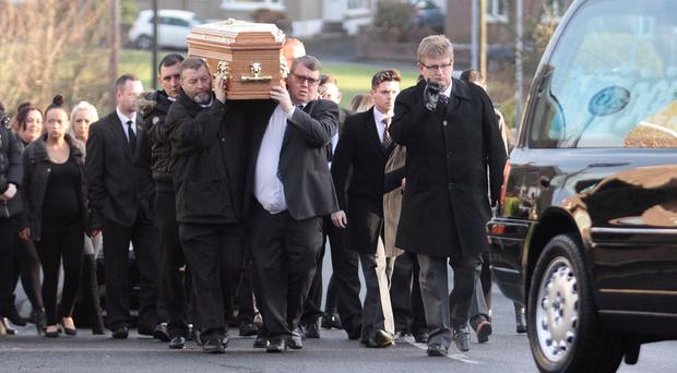 Family and friends carry the coffin of Colin Doherty