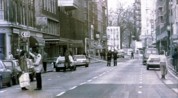 Police at the scene outside Harrods after the bombing in 1983
