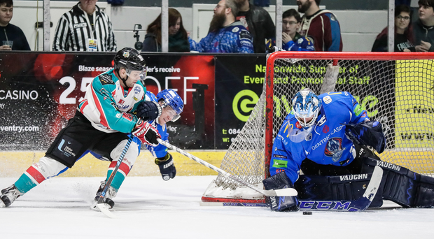 Giant stride: David Rutherford threatens the Coventry goal
