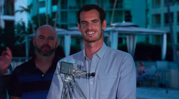 Number one: Andy Murray collects his award in Miami