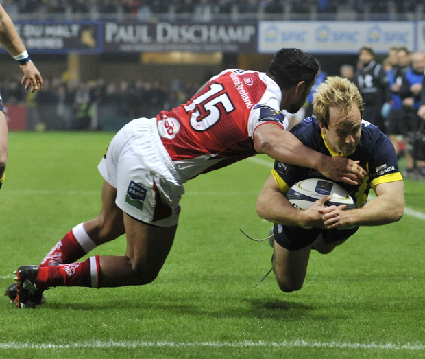 Tough lesson: Charles Piutau desperately tries to stop Clermont's Nick Abendanon score
