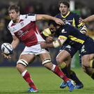 Close attention: flanker Chris Henry lays off the ball as Clermont players close in