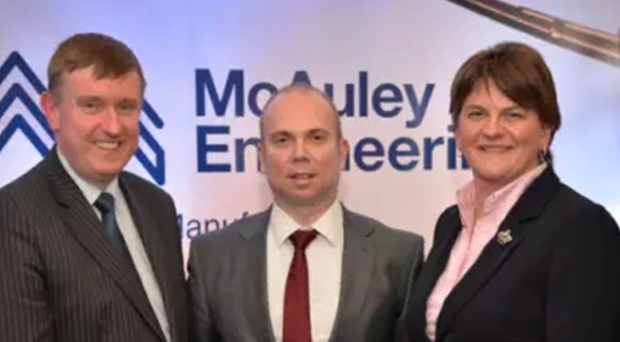 Heating cash:  Former Finance Minister Mervyn Storey, Jonathan McAuley (McAuley Engineering) and First Minister Arlene Foster