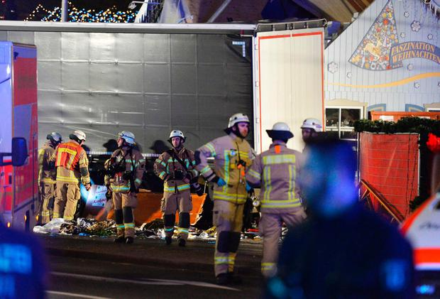 Medics and firefighters work at the scene where a truck crashed into a christmas market at Gedächniskirche church in Berlin, on December 19, 2016 killing at least nine people and injuring at least 50 people. AFP/Getty Images