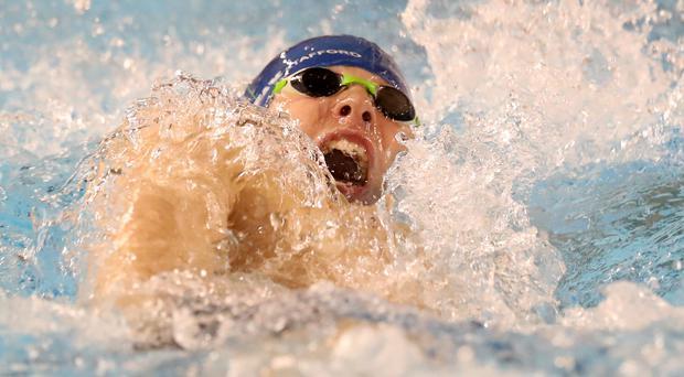 Making waves: Young Paddy Johnston won three medals