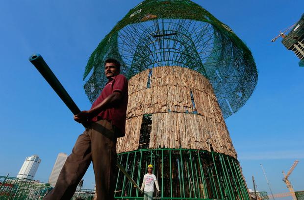 Sri Lankans rush to build 'world's tallest' Christmas tree on time ...