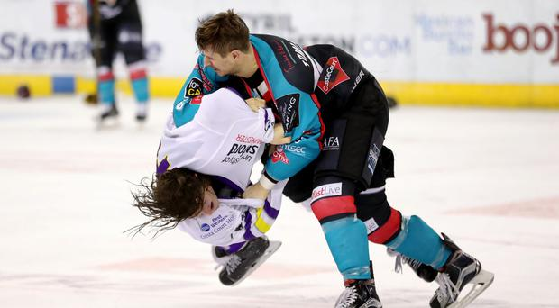 Belfast Giants' Matt Towe with Manchester Storm's Connor Varley during Tuesday nights Challenge Cup Quarter Final at the SSE Arena, Belfast. Press Eye - Belfast - Northern Ireland - 20th December 2016 - Photo by William Cherry