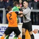 Opinion is divided: Daniel Hughes and Carrick keeper Brian Neeson clash before the Cliftonville striker was shown a red card by referee Mervyn Smyth. Photo: Matt Mackey/PressEye