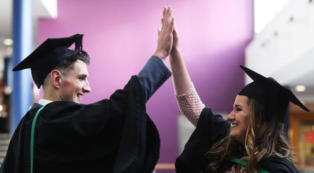 High Five! Lauren Sheridan celebrates her graduation along with brother Stephen who also graduated at the Ulster University Winter Graduation at Jordanstown. Lauren graduated in Occupational Therapy with brother Stephen graduating with a BSC in sports science. Picture John Murphy Aurora PA