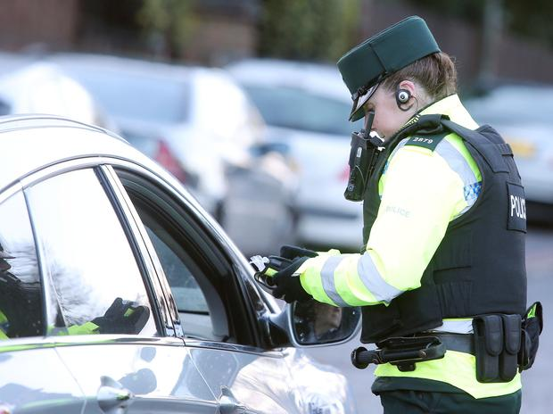 PSNI continue their anti-drink driving campaign with roadside breath tests on the Upper Malone Road in Belfast. Picture by Jonathan Porter/Press Eye