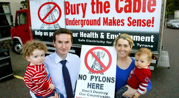 Fergal and Orla Woods with their children who are opposed to the use of overhead pylons as part of the north-south Interconnector. Fergal is an active member of the Safe Electricity Armagh and Tyrone committee.