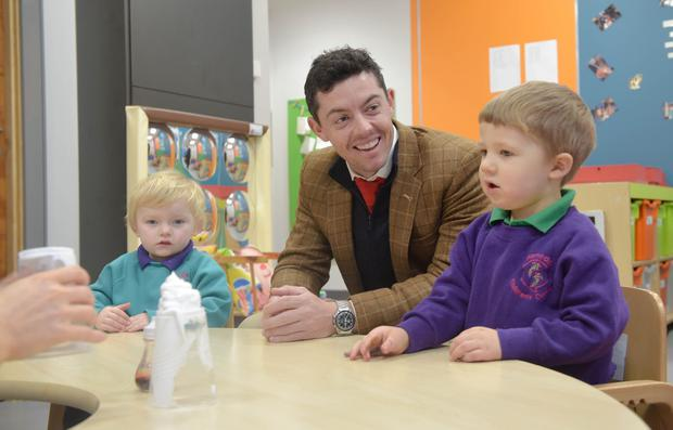 Rory McIlroy with Harley Ashman (2) and Oskar Johnstone (2), who both attend the nursery.