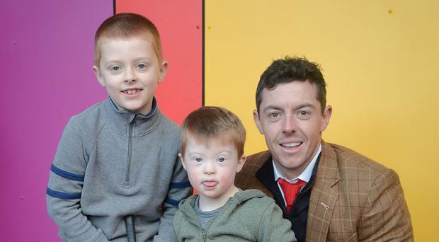 Rory McIlroy with Eoin Burrows (7) and brother Aodhan (4).