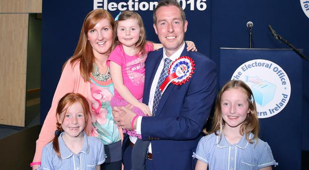 Proud parents: Paul Givan and his wife Emma with children Annie, Hollie and Maisie