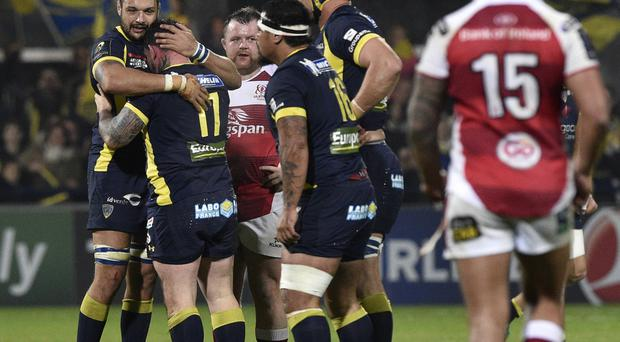 Sinking feeling: Dejected Ulster players can only look on as Clermont celebrate last Sunday's win