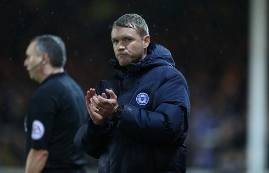 Plum tie: Grant McCann says his Peterborough side will have a real go at Chelsea