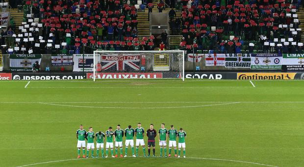 Remembrance: Before kick-off at the World Cup qualifier at Windsor Park on November 11